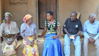 Myness, 15, chatting with her grandmother and child protection team, she was rescued from her marriage and resettled back to school